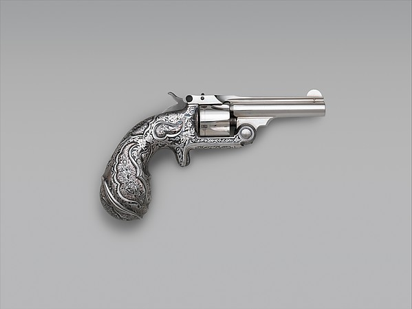 Tiffany & Co. Smith and Wesson .32 Single-Action Revolver, Serial no. 17156, ca. 1889–90 American, Springfield, Massachusetts and New York, Steel, silver, laminated metal; L., 7 1/8 in. (18.1 cm); barrel L., 3 in. (7.6 cm); Cal., .32 in. (8 mm); Wt., 15 oz. (438 g) The Metropolitan Museum of Art