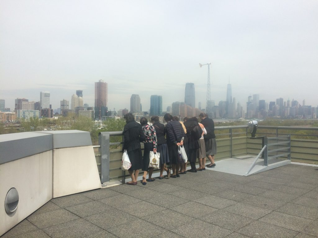 Eight Hasidic girls enjoy the view from the Liberty Science Center.