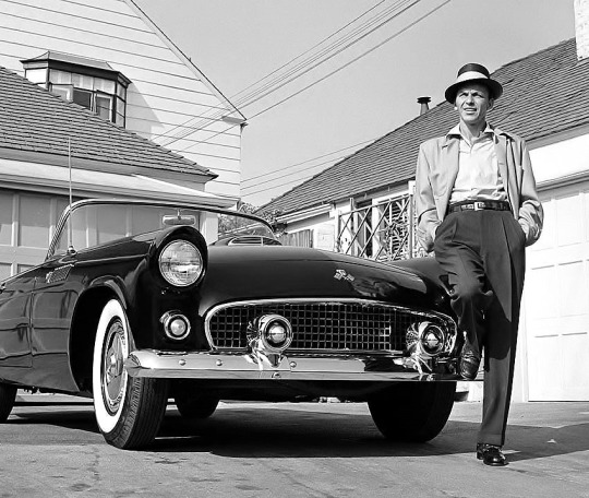 Frank Sinatra poses with his 1955 Ford Thunderbird.
