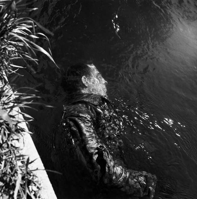 Lee Miller (1907-1977) SS Guard in Canal, Dachau, Germany 1945 © Lee Miller Archives England 2015. All Rights Reserved