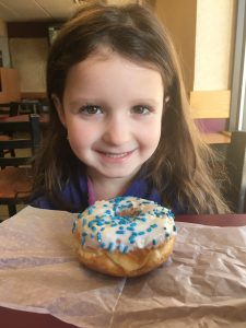 Lielle Meital enjoys a Dunkin' Doughnut in the colors of the Israeli flag.