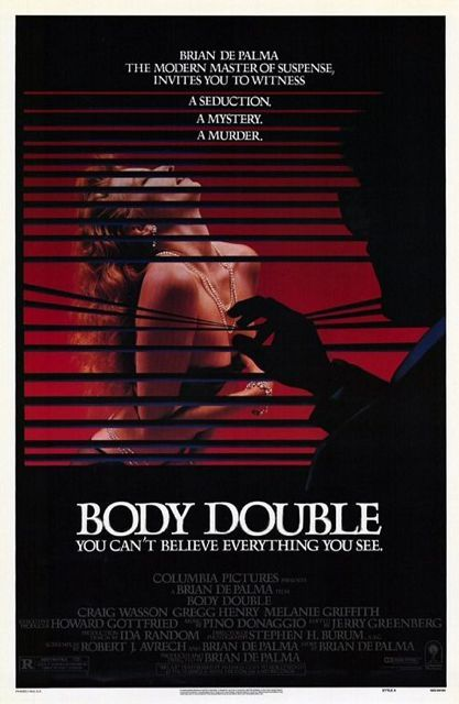 "This is not just shameless self-promotion but a lesson in what's wrong with current movie posters. ""Body Double"" (1984) was my first Hollywood credit. The peeping tom graphic is powerful and entirely appropriate. The problem is the massive block of credits at the bottom. Union contracts mandate font size and placement. And yes, I'm proud to have my name on posters. But currently credits take up as much as a third of every poster which greatly limits graphic creativity."