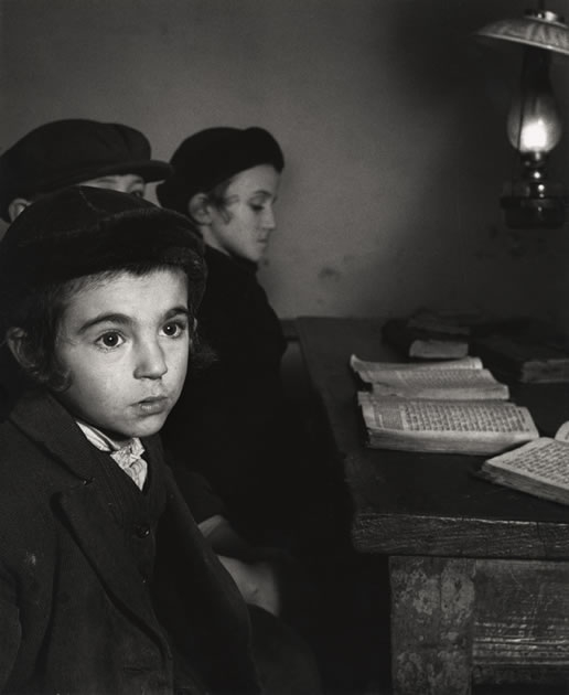 Roman Vishniac David Eckstein, seven years old, and classmates in cheder (Jewish elementary school), Brod, Czechoslovakia 1938
