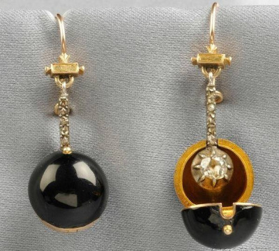 "Victorian ""coach cover"" earrings – detachable orbs known as coach covers were used to disguise diamond earrings during the daytime or while traveling as a precaution against thieves."