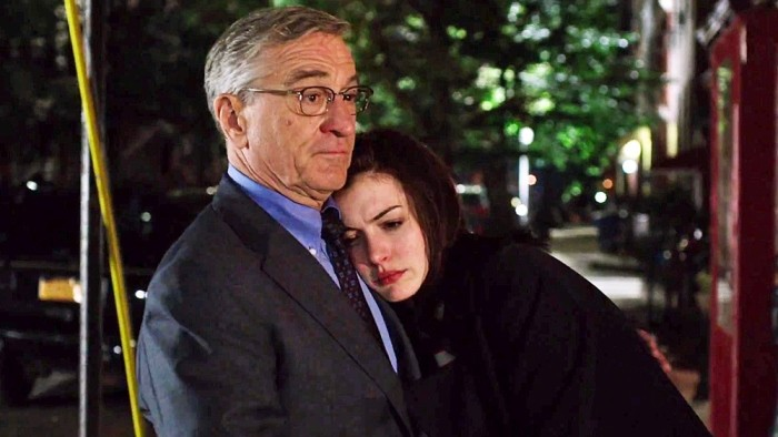 Ann Hathaway clings to a father figure, Robert De Niro, in The Intern.