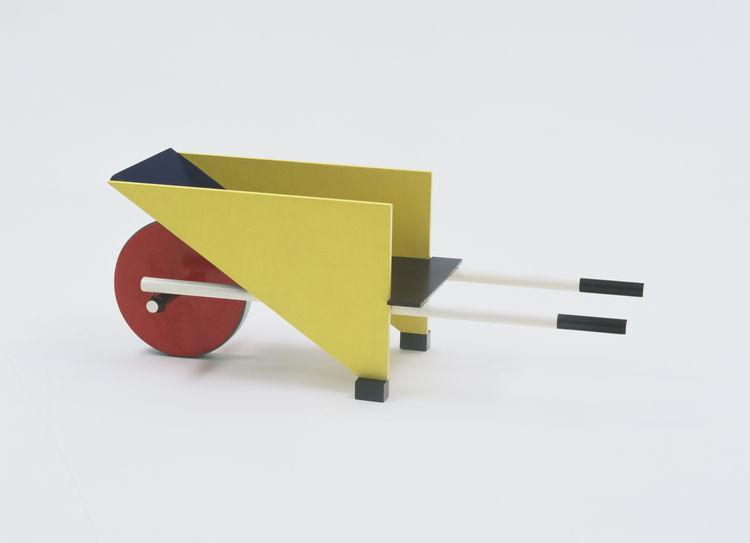 Wheelbarrow by Dutch architect and furniture designer Gerrit Rietveld embodies key elements of the De Stijl movement: basic geometric shapes and primary colors. Gerrit Rietveld, Child's Wheelbarrow, 1923. Painted wood.