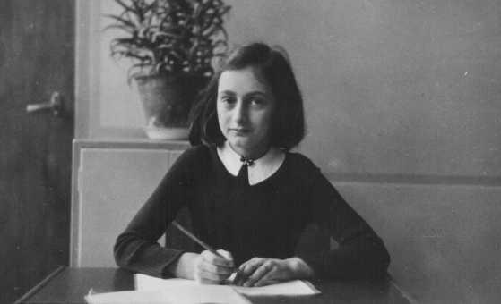 Anne Frank, age 12, at her school desk in Amsterdam. diarist. Frank, a one of six million Jewish victims of Nazi genocide, was a Deanna Durbin fan.