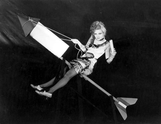 Here's Helen Twelvetrees on a July 4th firecracker. This photo, circa 1930s, is, let's face it, more tasteless than most Hollywood cheesecake. The picture also serves as an apt metaphor for Helen's career which took off like a rocket and plunged to earth just as quickly.