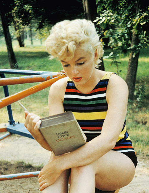 "Marilyn Monroe reading Ulysses by James Joyce. Photographed in 1955 by Eve Arnold. ""She kept 'Ulysses' in her car and had been reading it for a long time. She said she loved the sound of it and would read it aloud to herself to try to make sense of it–but she found it hard going. She couldn't read it consecutively. When we stopped at a local playground to photograph she got out the book and started to read while I loaded the film. So, of course, I photographed her."" —Eve Arnold."
