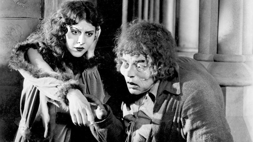 """Patsy Ruth Miller as Esmeralda and Lon Chaney as Quasimodo in Wallace Worsley's silent """"The Hunchback of Notre Dame,"""" 1923."""