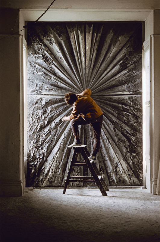 Jay DeFeo at work on her monumental painting, The Rose, which wears close to a ton.