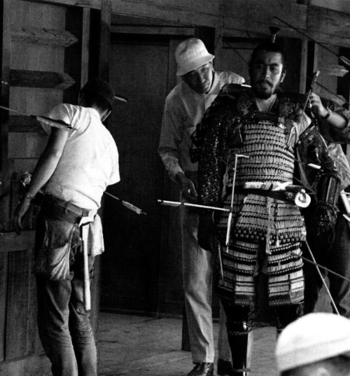 "Akira Kurosawa sets up the shot of Toshiro Mifune's death in Throne of Blood (1957) ""In order to write scripts, you must first study the great novels and dramas of the world. You must consider why they are great. Where does the emotion come from that you feel as you read them? What degree of passion did the author have to have, what level of meticulousness did he have to command, in order to portray the characters and events as he did? You must read thoroughly, to the point where you can grasp all these things."" —Akira Kurosawa, Something Like an Autobiography"
