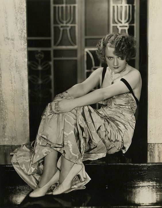 Carmel Myers, the Rabbi's beautiful daughter, photographed by Elmer Fryer for Warner Bros., 1920s.