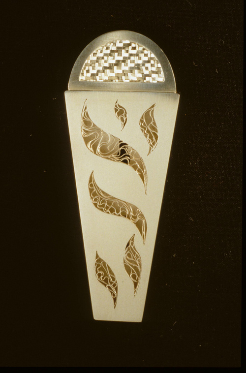 Munda Abigail Upin Sterling and fine silver mezuzah. Filigree and hand-woven silver. Size: 3 3/4 x 1 1/2 x 3/8 inches