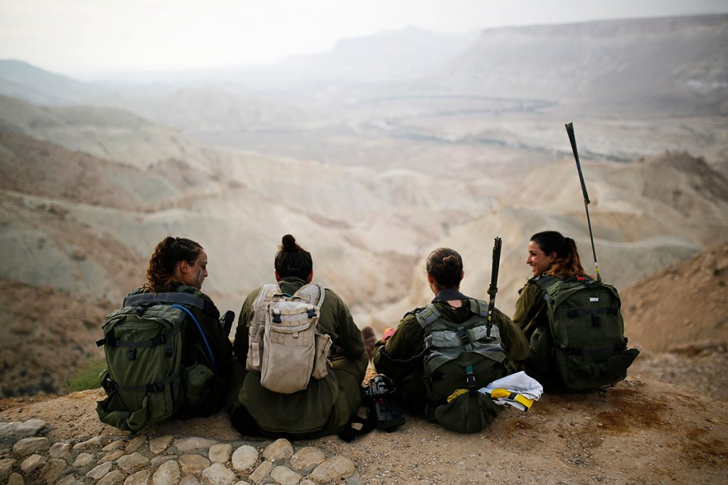 Amir Cohen Women of the Caracal Battalion rest after a grueling march, 2014