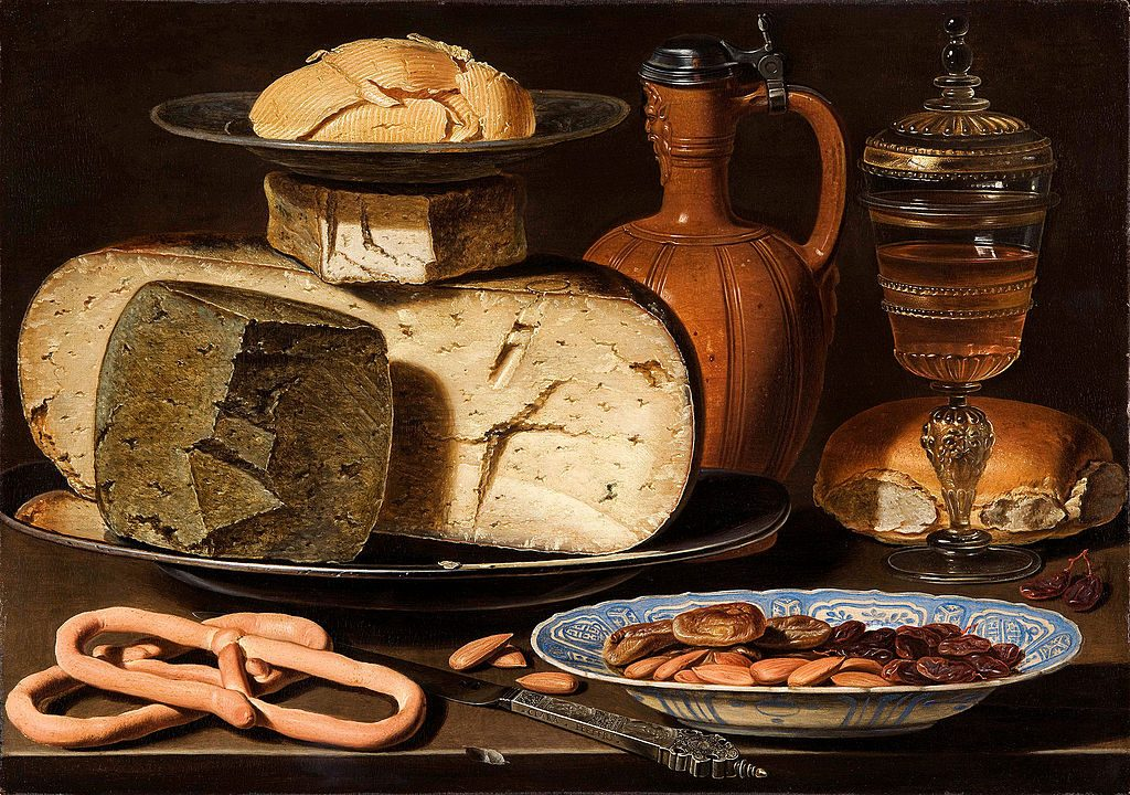 "Clara Peeters (1607-1621) Still Life with Cheeses, Almonds and Pretzels, c. 1615, with the ""signed knife"", and a reflection of the painter on the rim of the jug lid."