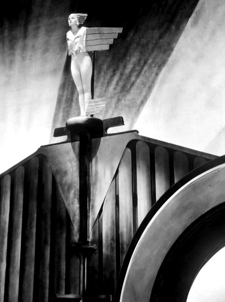 Corinne Griffith costumed as an Art Deco-style Rolls Royce hood ornament in Lilies of the Field, 1924 Art direction by Milton Menasco. Photographer: Irving Chidnoff