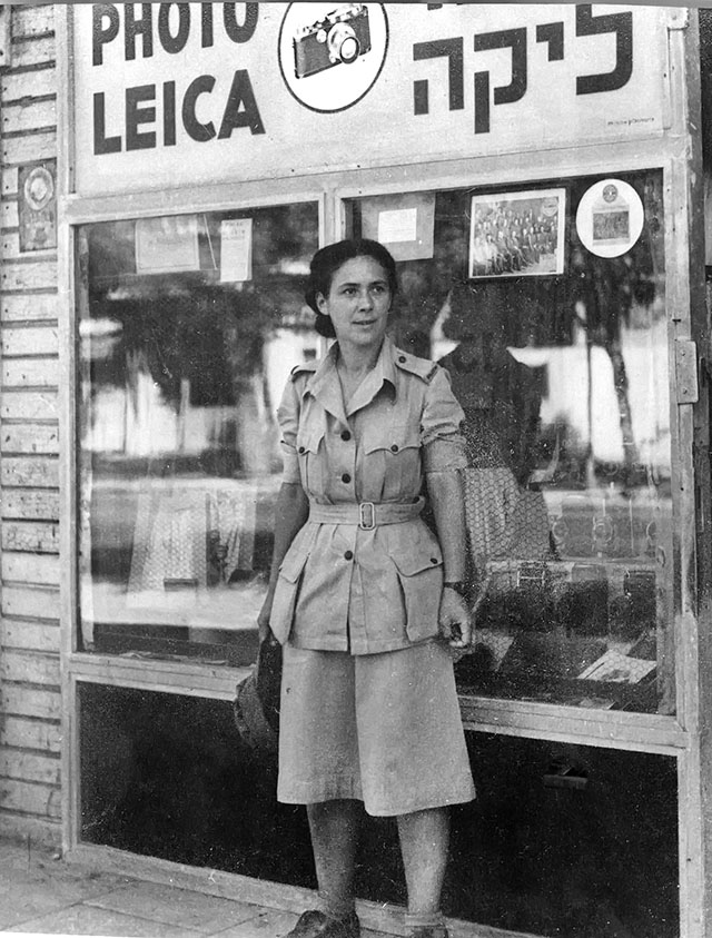 The Tel Aviv Leica Store in 1942. The woman in fron to of the store is Rachel Levy who is wearing the ATS uniform (women's branch of the British Army during the World War II and later merged into the Women's Royal Army Corps).