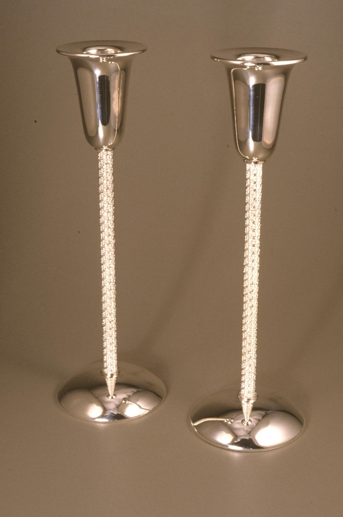 Munya Upin Sterling silver Shabbat candlesticks with hand-woven, fine silver stems. Size: 7 1/4 x 2 3/4 x 2 3/4 inches