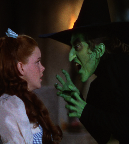 """Margaret Hamilton & Judy Garland in The Wizard of Oz (1939, dir. Victor Fleming) """"I suppose I've turned down a fortune [by refusing countless offers to re-create the role], but I just don't want to spoil the magic. Little children's minds can't cope with seeing a mean witch alive again. Many times, I see mothers and little children and the mothers always recognize me as the witch. Often, they say to the kids, 'Don't you know who she is? She's the witch in The Wizard of Oz! Then the kids look worried and say, 'But I thought she melted.' It's as though they think maybe I'm going to go back and cause trouble for Dorothy again."""" -Margaret Hamilton, The Washington Post (1973)"""
