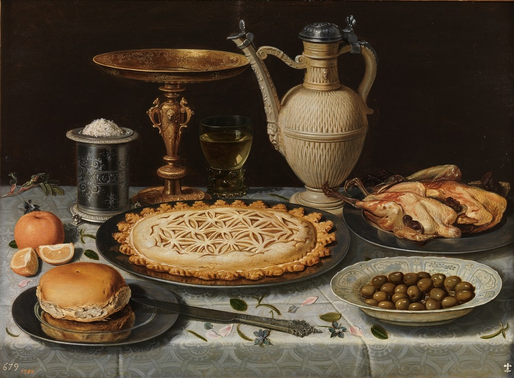 Clara Peeters Table with Cloth, Salt Cellar, Gilt Standing Cup, Pie, Porcelain Plate with Olives and Cooked Fowl (1611). Image courtesy of Museo del Prado.