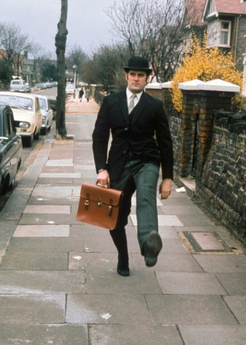 """Monty Python: Ministry of Silly Walks (1970) """"If I had not gone into Monty Python, I probably would have stuck to my original plan to graduate and become a chartered accountant, perhaps a barrister lawyer, and gotten a nice house in the suburbs, with a nice wife and kids, and gotten a country club membership, and then I would have killed myself."""" -John Cleese, 1997"""