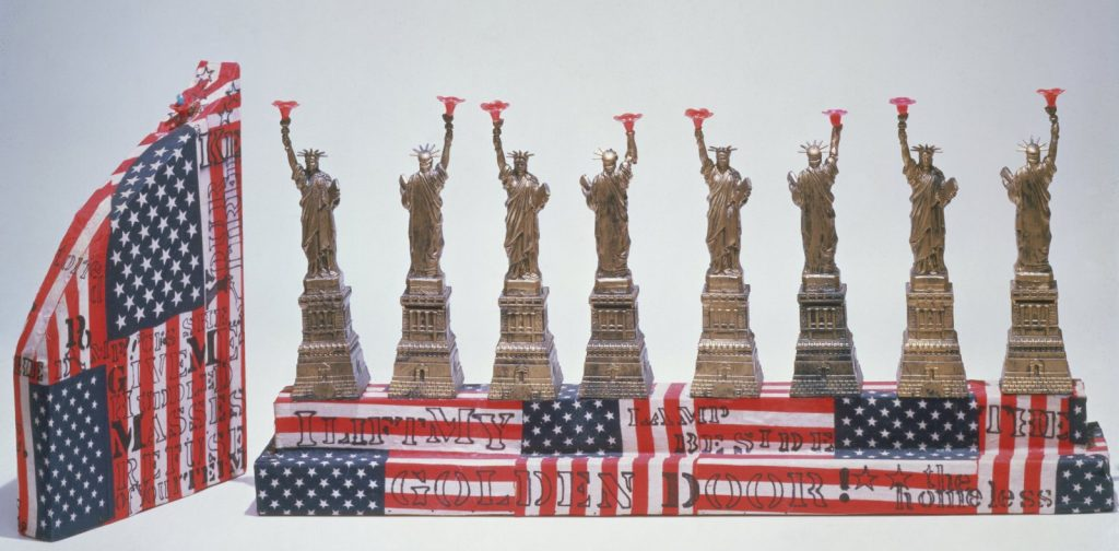 Hanukkah Lamp Miss Liberty Mae Rockland Tupa, American, b. 1937 Princeton, New Jersey, United States, 1974 Wood covered in fabric; plastic: molded 11 × 24 × 7 in. (27.9 × 60.9 × 17.8 cm) The Jewish Museum, New York Gift of the artist, 1984