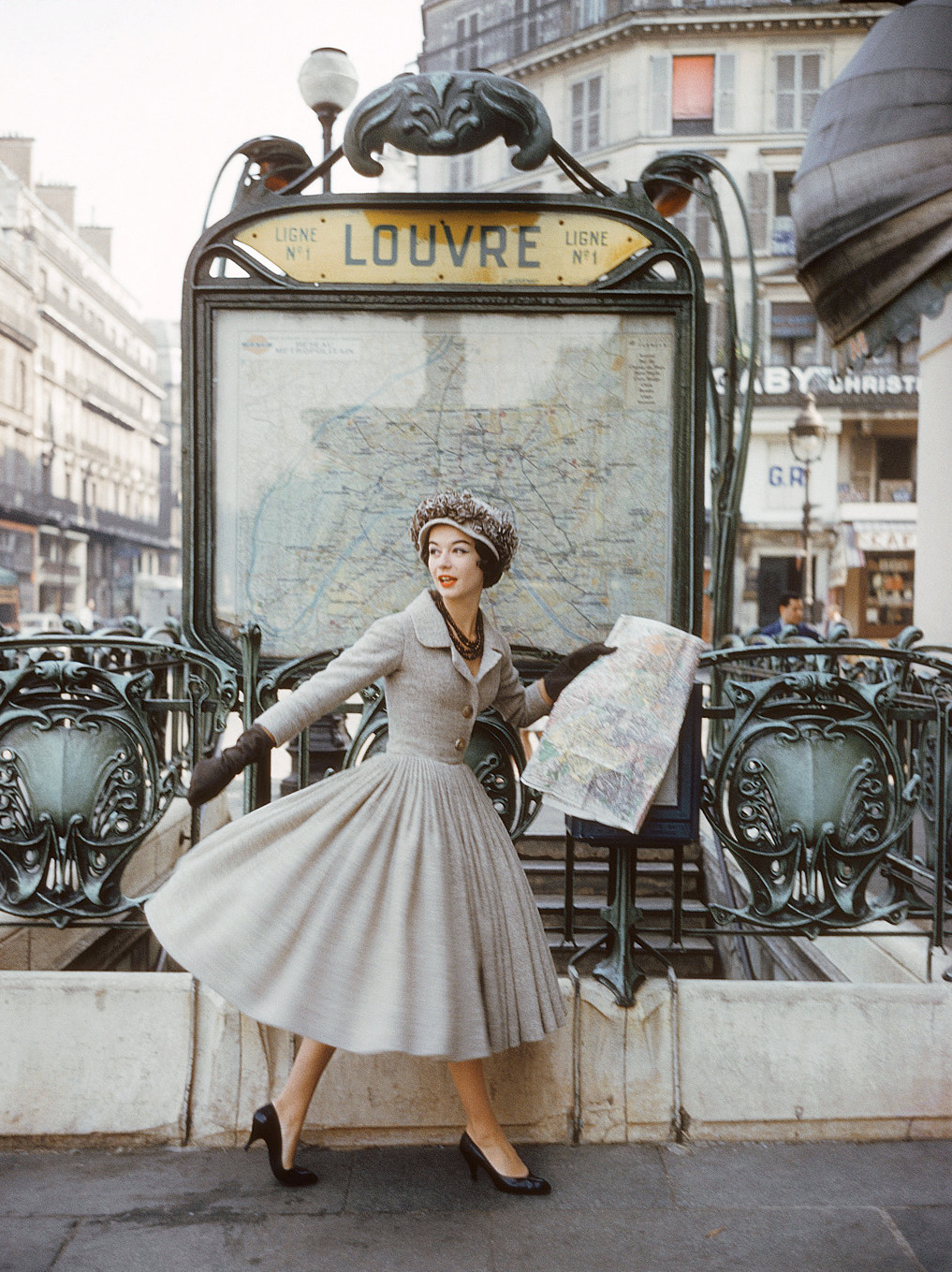 Model wearing an afternoon dress by Christian Dior in a photo by Mark Shaw, Paris, 1957